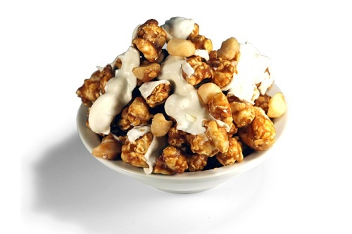 ... flakes blended with white chocolate on our buttery caramel popcorn