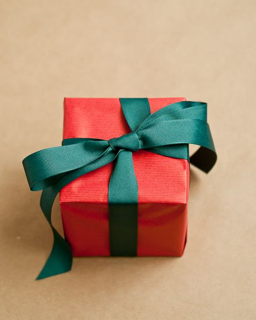 Tutorial on how to properly wrap a gift with wrapping paper.