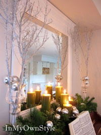 I took branches from crepe mrytle and did this outside around my door.  Add, lights, icicles, and some grapevine and get the effect of an icy winter tree.