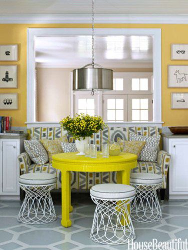 Yellow kitchen dining area. Design: Lindsey Coral Harper. Photo: Ngoc Minh Ngo. housebeautiful.com. #yellow #diningarea #paintedfloor #pendantlight