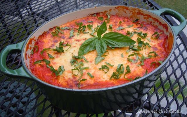 Eggplant ricotta bake; I think I'd add hamburger to the red sauce