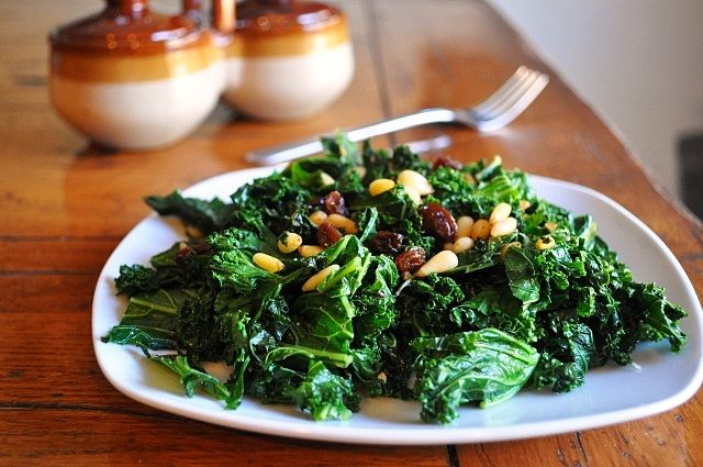 """... greens, but this """"Sauteed Kale with Pine Nuts and Raisins"""" is a..."""