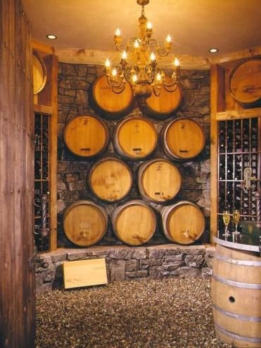 Now this is a fancy wine cellar!  (Silly, but I'm thinking that we could get wine barrels, use them as a divider and they would be hinged to reveal storage!-L)