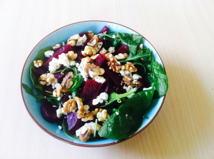 Spinach, walnut, beet and blue cheese salad with mustard vinaigrette.
