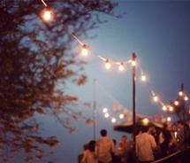 Lights strung around poles at night
