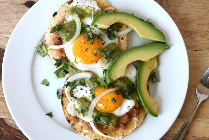 Huevos Rancheros - Corn tortillas with refried beans, fried eggs and ...