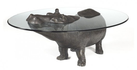 Awesome Hippopotamus Table by Scottish sculptor and furniture designer Mark Stoddart.    Glass size 4.5′ x 3′ 12mm thick toughened glass bevelled edges conforming to British Standards BS76206 but can be made to suit. -sculptart.co.uk