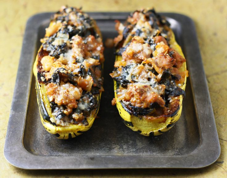 Delicata squash stuffed with Italian sausage, beans and kale, as ...