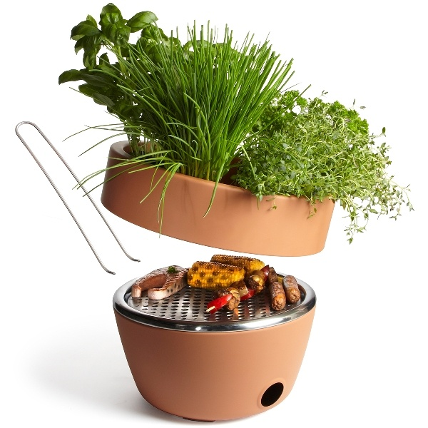 Give your backyard BBQs a fresh piqué by growing herbs in this terracotta pot with a grill inside.