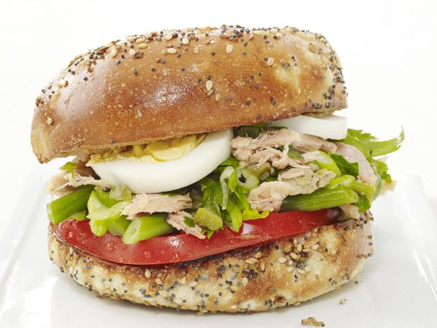 Turn an everything bagel into a tasty dinner by topping it with tuna salad and eggs. #FNMag