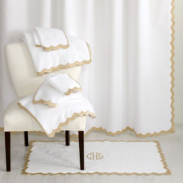 Matouk scalloped shower curtain, terry towels, and bath mat