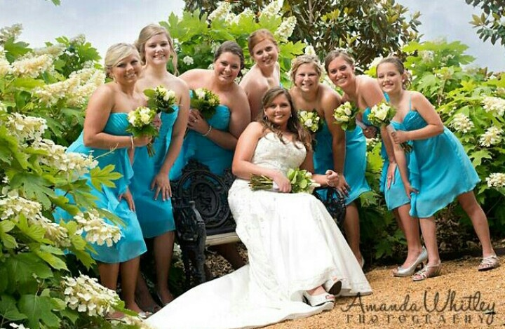 Bridal Party Bridesmaids and Bride gorgeous turquoise dresses