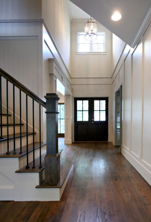 Black door high ceiling foyer woodwork pinterest for High ceiling entryway
