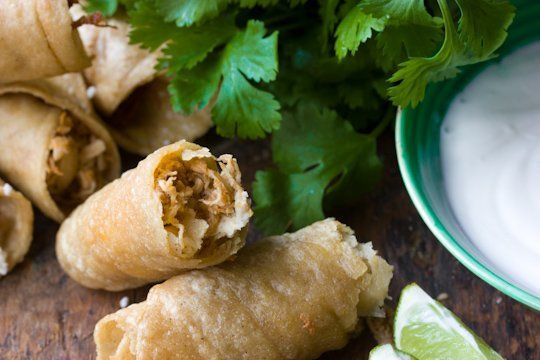 recipe spicy chicken flautas with lime sour cream the kitchn