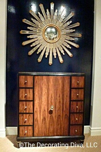 Elegant vignette at @JohnRichardCol: Mid-century cabinet topped with gilded sunburst mirror. #hpmkt