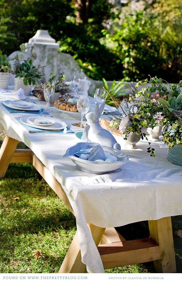 This outdoor table looks fantastic... simple palette with pale blue... love the rabbits!