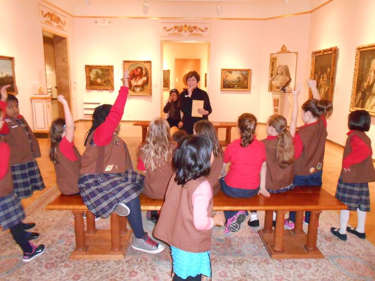 Members of a local Girl Scout troop match emotions to works of art during an Eye Spy tour of the D'Amour Museum of Fine Art.