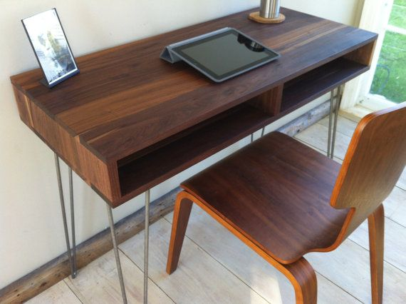 Mid century modern desk featuring black walnut and hairpin legs.