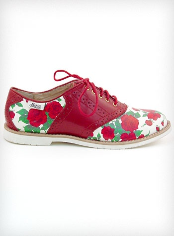 Rosy Disposition Saddle Shoes...Show off your rosy disposition with these adorable vintage inspired 1950's style saddle shoes designed by Rachel Antonoff. They feature an off-white body covered in lovely red roses and green leaves, contrasting deep red leather details and trim, white rubber soles, and red laces. This classic saddle-shoe style, with a modern twist, easily compliments a variety of different outfits - from vintage dresses to modern T-shirts and cropped jeans ♥