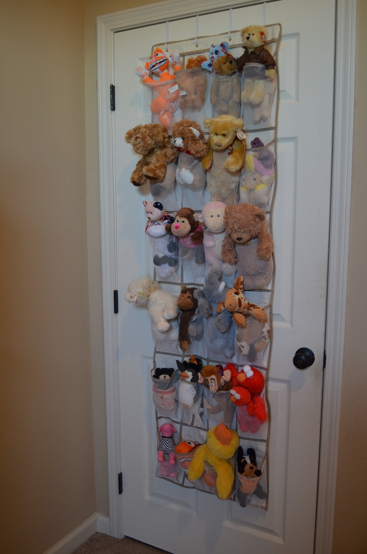 stuffed animal storage using a hanging shoe organizer. Fairly cheap from Walmart and hung over my daughters bedroom door.