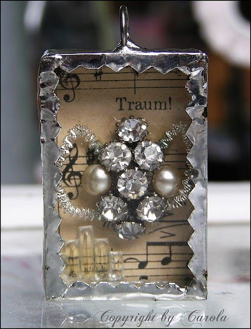 Silver soldered trinket box with vintage bling and old German sheet music background.
