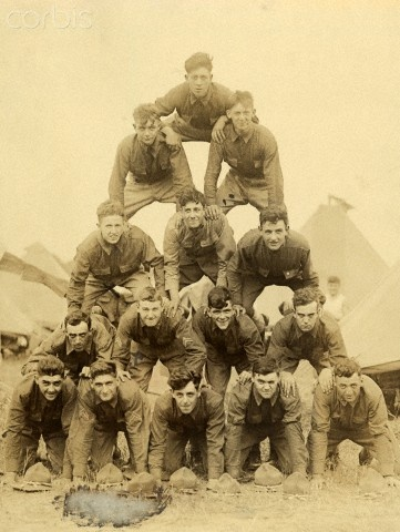 American soldiers in a World War I training camp form a pyramid.