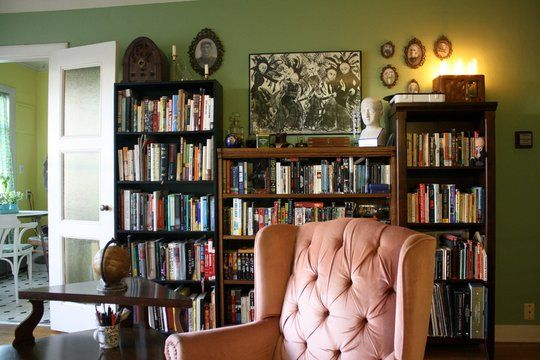 wall of mismatched bookshelves!