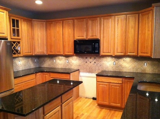 Dark countertops light cabinets kitchen ideas pinterest for Dark kitchen countertops