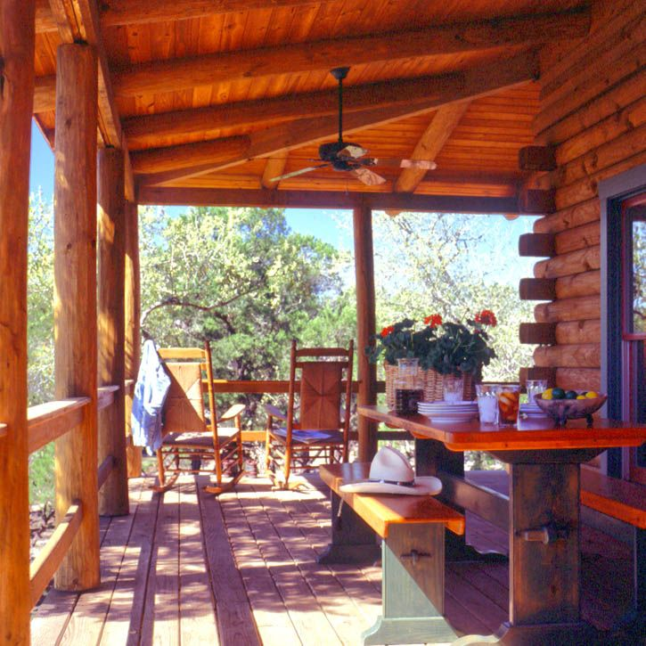Log home covered porch log homes inside out pinterest for Log home porches