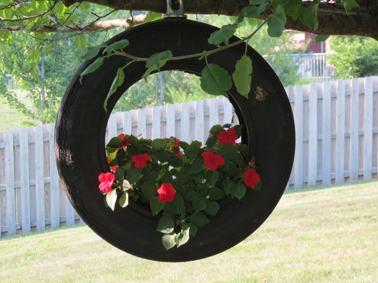 Hanging planter made from an old tire plants posies - Planters made from old tires ...