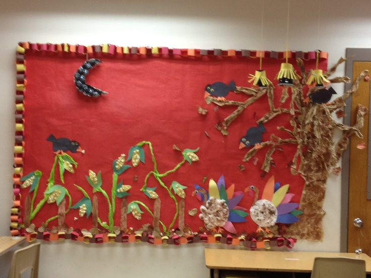 Our classroom bullitin board.  Each month we create a themed board that the kids help create. This one is for November; corn made with construction paper and popped corn and tissue paper;  turkeys made with paper, paint, and cotton balls; a tree made from brown paper bag and paint, scare crows 1) made with const. Paper 2) made from black plastic cups; a moon made from egg carton, paint and glitter.  The kids made the boarder chain as well