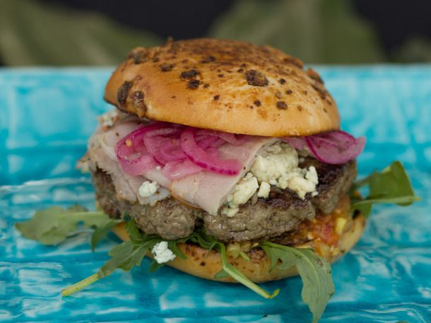 Blue cheeseburger with shaved ham, arugula, tomatoes, pickled onions ...