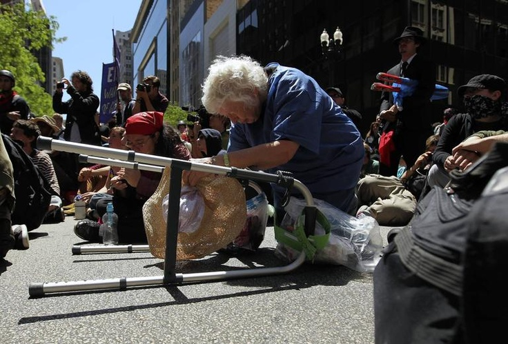 Nan Wigmore, a great-grandmother from Portland, Ore., takes a rest on State Street during a march from Boeing to President Obama's campaign headquarters.