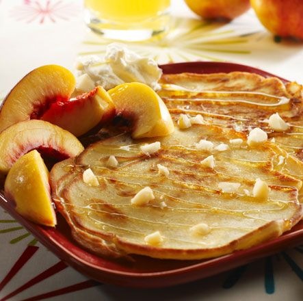 Fluffy vanilla pancakes with sliced white nectarines and honey drizzle ...