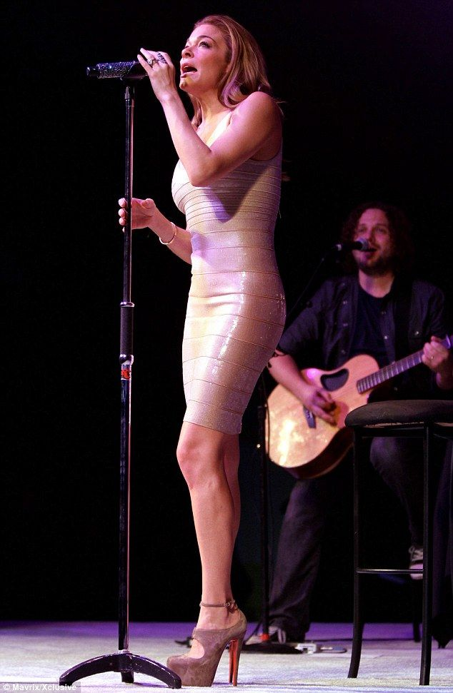 Impressive legs and high heels. LeAnn Rimes performed at the Kick It Off & Kick It Up anniversary gala at The Autry National Center in a skin tight dress and sky high heels #heels #legs #LeAnn_Rimes