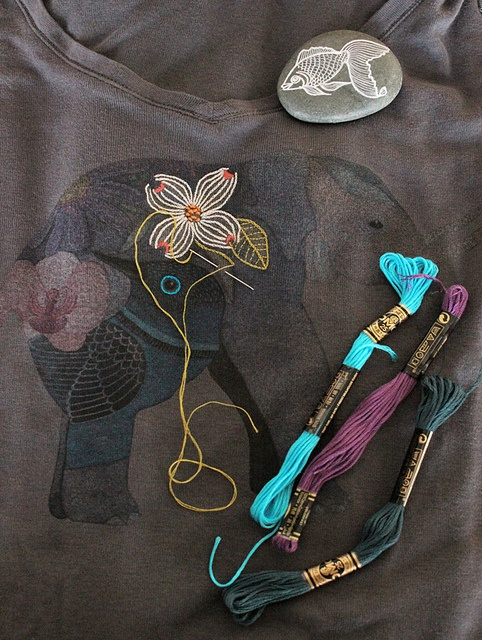 @Geninne D Zlatkis is embroidering one of her designs on to a favorite t-shirt