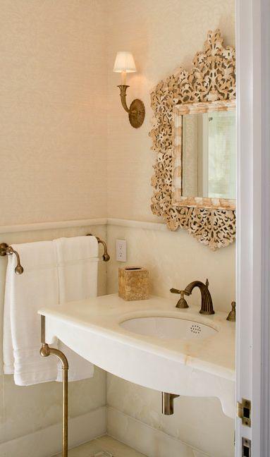 ornate mirror + marble washbasin