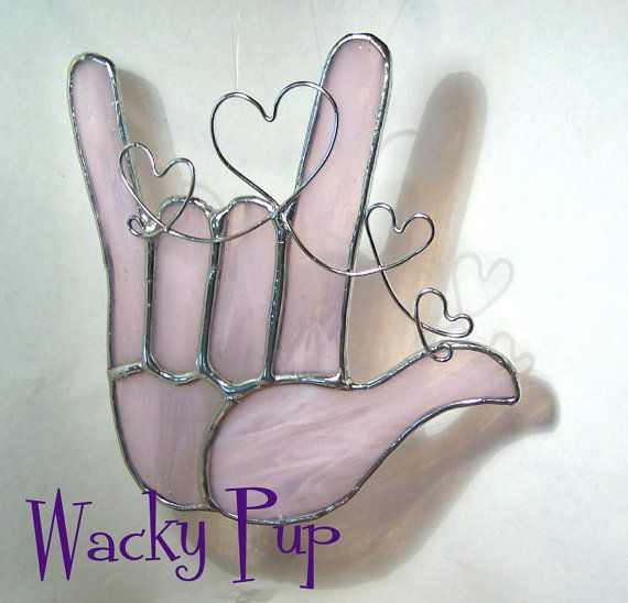 sweet soft pink american sign language i love you hand