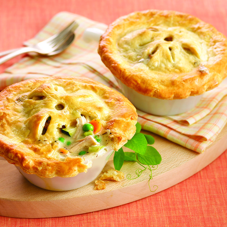 These individual puff pastry-topped chicken pot pies are the perfect ...