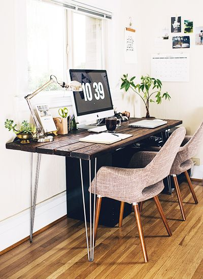 beautiful office space with wood tones and neutral furnishings