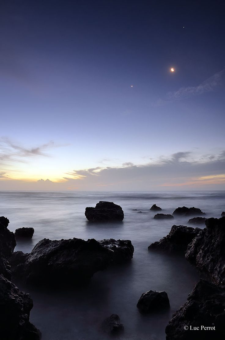 Explanation: You don't have to be on Reunion Island to see this week's planetary conjunction. Only if you want to see this picturesque seascape as well. To see the conjunction from just about anywhere in the world, look to the west after sunset. The first planet you may notice is Venus, the brightest object in the western sky. Above Venus, the second brightest object is Jupiter. (March 7th 2012)