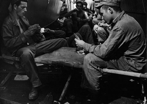 US Marines play cards while their troop ship carries them to the hell they will come to know as the Battle of Iwo Jima