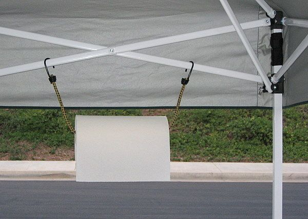 Hang a paper towel roll using a bungee cord from the tent struts.   41 Tailgating Tips That Are Borderline Genius