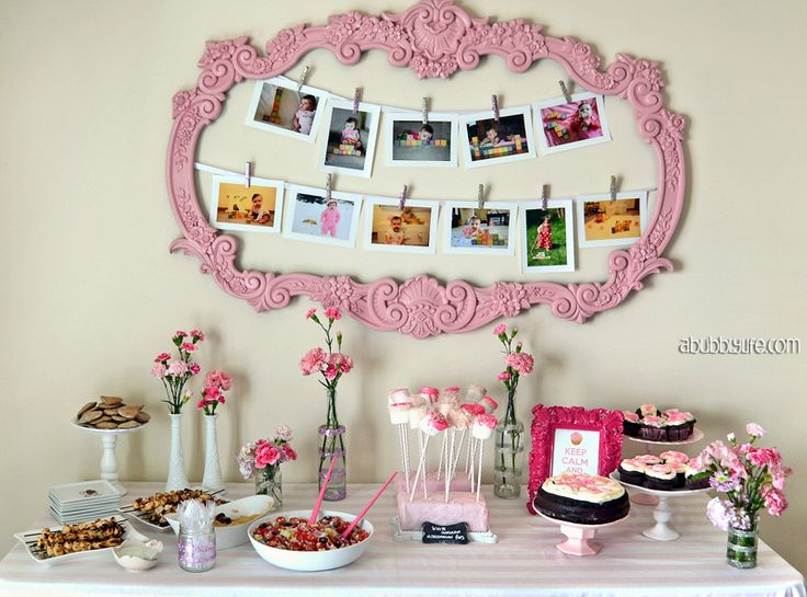 This old garage sale find frame was spray painted and used to hang monthly pictures. SO adorable! #firstbirthday