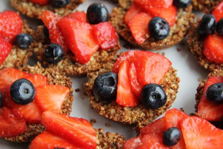 Strawberry blueberry tarts in a ginger nut crust