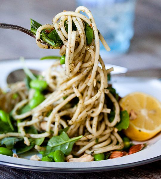 Pesto pasta with lemon, spinach, edamame and toasted almonds.