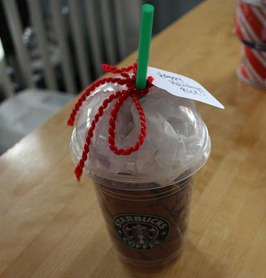 Ask The Barista for a clean cup and lid. Stuff with brown and white tissue. Slide Starbucks gift card inside :) -ridiculously good idea!