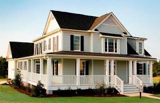 Love the wrap around porch on this house!