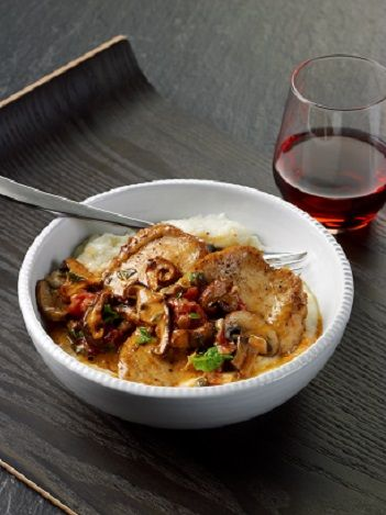 ... ! Chicken with Wild Mushrooms, Tomatoes, and Capers over Garlic Grits
