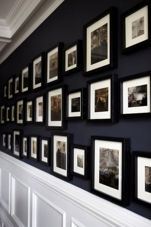 Interesting idea....perhaps for my own hallway though I think the black frames is not so right with the navy blue.